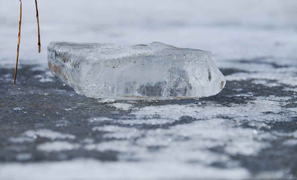 chunk of ice on frozen water